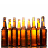 Tall beer bottles with no labels and metal caps Stock Photography