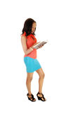 Tall black girl reading. Royalty Free Stock Image
