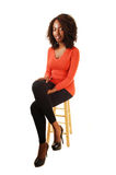 Tall black girl sitting. Stock Photos