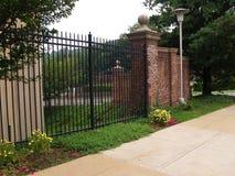 Tall black iron fence Royalty Free Stock Photo