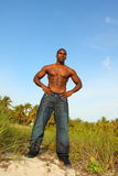 Tall Bodybuilder. Wearing jeans and standing outside Stock Photography