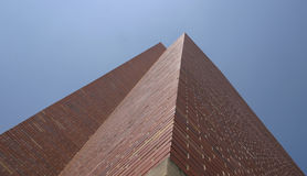 Tall Brick Building. Against a bright blue sky royalty free stock photography