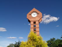 Tall brick clock tower Stock Images