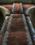 Tall brick pillar. A tall pillar made from red bricks Stock Photo