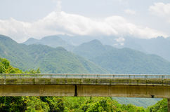 Tall bridge over a green valley Royalty Free Stock Images