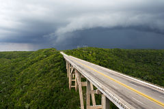 Tall bridge in a stormy weather. With interesting clouds in the sky Stock Photos