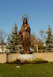 A tall bronze statue of Mother Mary. Royalty Free Stock Image
