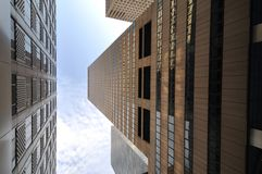 Tall building. Bottom view of two buildings on a street in New York City Royalty Free Stock Photos