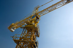Tall building crane. Over blue sky Stock Photo