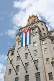Tall building with a cuban flag. Havana, Cuba Royalty Free Stock Photos