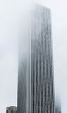 Tall Building Into Fog Royalty Free Stock Photos