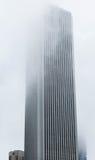 Tall Building Into Fog Royalty Free Stock Photos