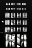 Tall building with lighted windows. At night Stock Image