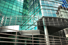 Tall Building with Many Windows. Mirror-walled business center with reflection of cloudy sky Stock Image