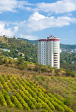 Tall building in mountains Royalty Free Stock Photo
