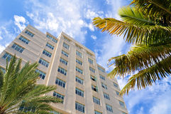 Tall building with palm trees. Art deco high-rise building, with palm trees and bright blue sky.  Taken in Miami South Beach, Florida Royalty Free Stock Photo