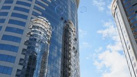 Tall building with reflection of other buildings in its windows stock video