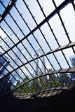 Tall building seen through glass roof Royalty Free Stock Image