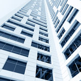 Tall building with shining windows in white walls Royalty Free Stock Images