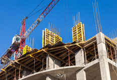 Tall building under construction with crane Stock Photography