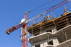 Tall building under construction with crane Royalty Free Stock Image