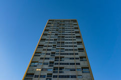 Tall building with windows against blue sky on the background Stock Photo