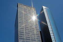 Tall buildings. Sun reflecting off the glass of a tall building Royalty Free Stock Photography