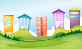 Tall buildings across the hills Royalty Free Stock Photo