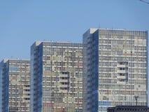 Apartments& x27;d sun bathing. Tall buildings blue sky Royalty Free Stock Photo