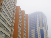 Tall buildings in the fog. In city Royalty Free Stock Photo