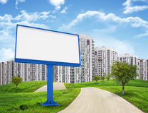 Tall buildings, green hills and road with large Royalty Free Stock Photo