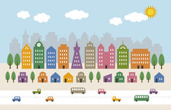 Tall buildings and houses in city Stock Images