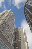 Tall buildings low angle on blue sky. Tall buildings low angle view on blue sky Royalty Free Stock Image
