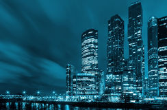 Tall buildings of a Moscow city reflected in water at twilight Royalty Free Stock Images