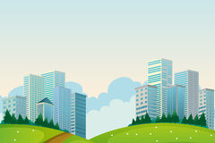 Tall buildings near the hills Royalty Free Stock Photo