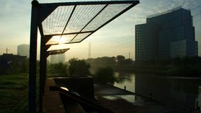 Tall buildings, rivers, and sun. a captivating composition for a moment in the morning. Wonderfull Surabaya stock image