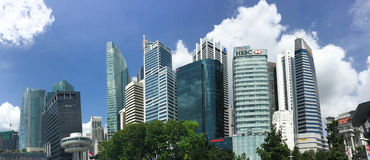 Tall buildings in Singapore. Many tall buildings rising in business district, Singapore. Singapore's largest companies are in the telecoms, banking Stock Photo