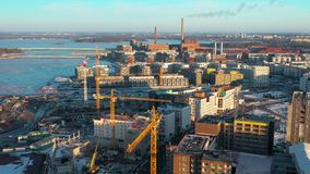 Tall buildings and smoke coming out from factories in Helsinki Finland stock video