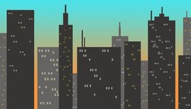 City buildings at sunset. Tall buildings with some lights in the windows on a blue background weathered to yellow simulating sunset Stock Photos