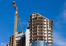 Tall buildings under construction with cranes Royalty Free Stock Photo