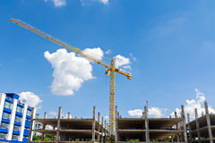 Tall buildings under construction with cranes Stock Images