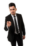 Tall businessman pointing the finger at you Royalty Free Stock Image