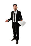 Tall businessman waiting for a client to sign a contract Stock Photography