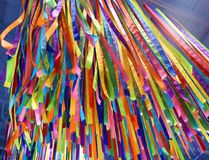 Tall ceiling hangings of colorful strips of assorted fabric. Assorted fabric and colors as a wall and ceiling hanging in a children`s play center Royalty Free Stock Image