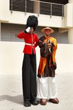 Tall characters entertaining people at F 1 village, Bahrain Royalty Free Stock Photo