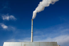 Tall chimney with smoke Royalty Free Stock Images