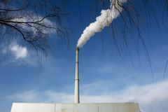 Tall chimney with smoke Stock Images