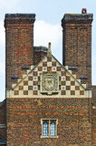 Tall chimneys on old house. Two tall brick chimneys on old house in England with tiled roof Stock Photos