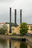 Tall chimneys at the shipyards. Royalty Free Stock Image