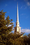 Tall church steeple. Low angle view of tall countryside church steeple with blue sky background Royalty Free Stock Photos
